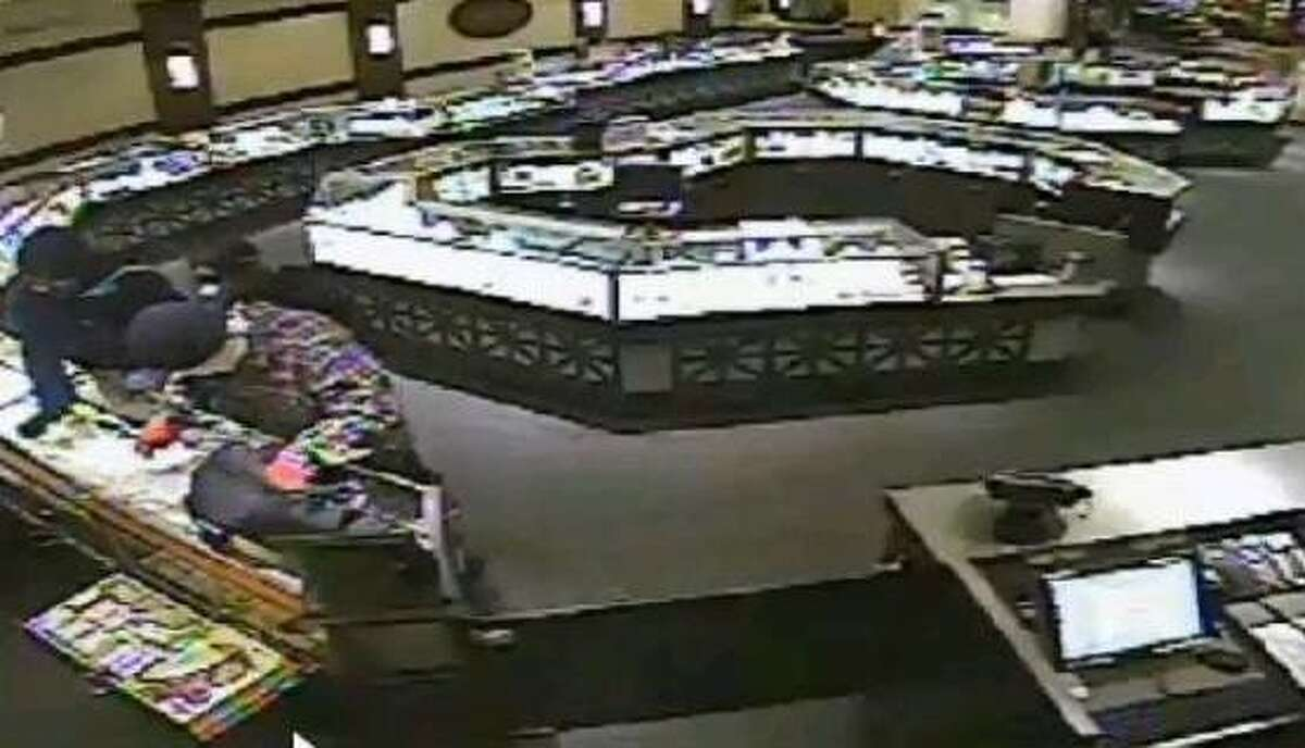 Surveillance cameras captured robbers in the act on Dec. 22 at Ben Bridge Jewelers in the Galleria.