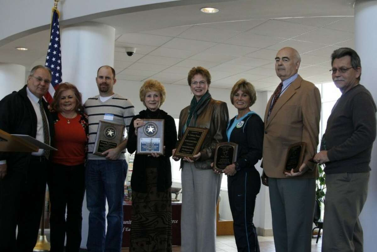From left, Gary Gardner, retiring board member; Angela Allen, outgoing chairman; Kevin Kennedy of Kennedy Fabricating, large business of the year; Pam Dickson with The Mission, small business of the year; Dr. Katherine Persson with Lone Star College-Kingwood, Hometown Hero; Katie Paris with Embody Fitness, volunteer of the year; Mike Harris, retiring board member and board member of the year; and Vern Reichert, ambassador of the year.