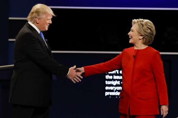 Republican presidential nominee Donald Trump and Democratic presidential nominee Hillary Clinton shake hands during the presidential debate at Hofstra University in Hempstead, N.Y., Monday, Sept. 26, 2016. (AP Photo/David Goldman)