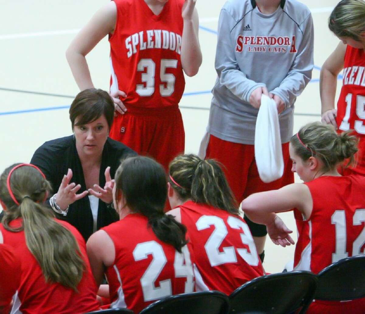 Splendora coach Dianna Archer talks to her team Thursday during the Taco Bell Holiday Classic in Willis.