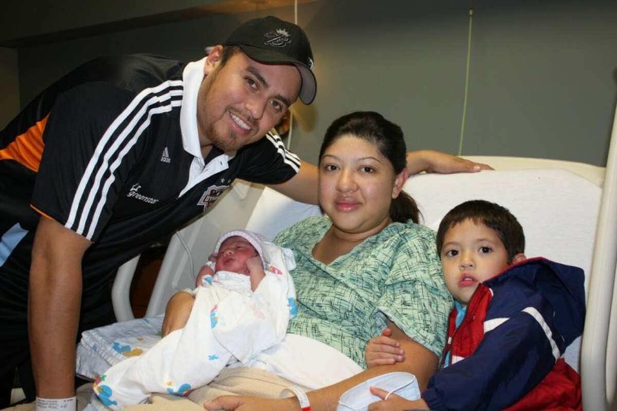 Baby Eliana makes her debut on New Year's Day at Kingwood Medical Center with big brother Isaac and parents Marta and Aureliano Peña.