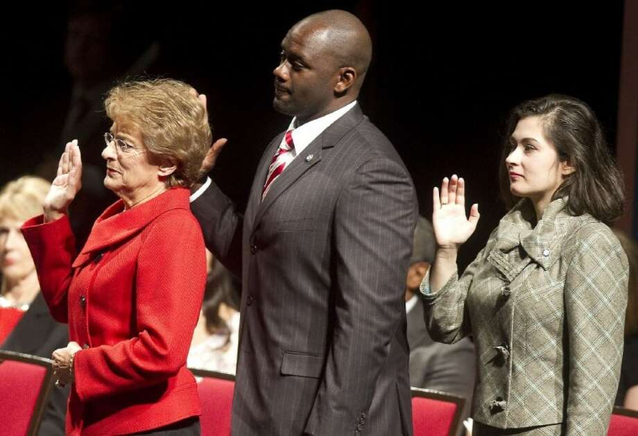New faces on council receiving the oath of office, in reverse alphabetical district order: Ellen Cohen, District C; Jerry Davis, District B; Helena Brown, District A.
