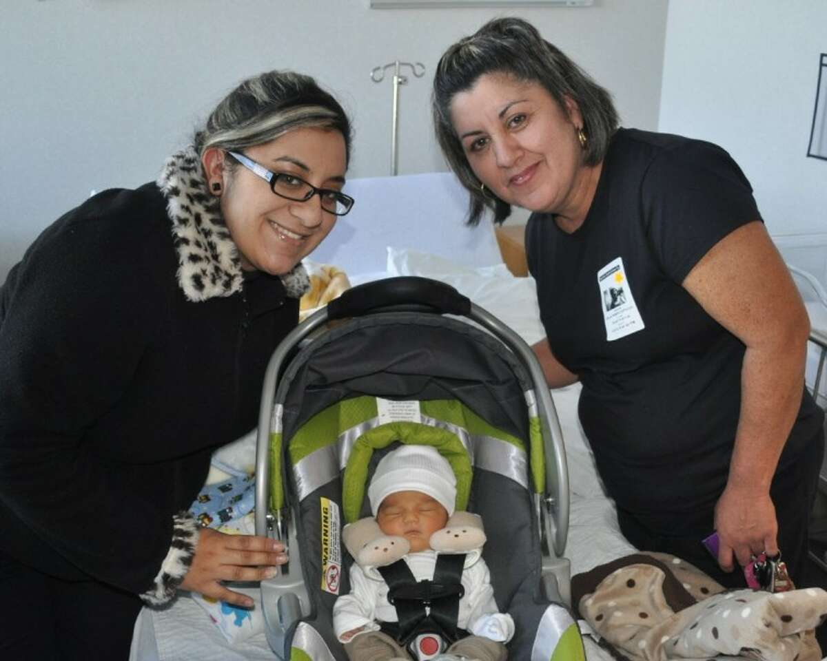 Pasadena resident Valery Espinoza Rodriguez, left, delivered the first baby of 2012 on Sunday just after 4 a.m. Luis Davian was over 7 pounds and was able to go home with his family on Tuesday. Pictured is Rodriguez, Luis Davian and grandmother Velia Espinoza.