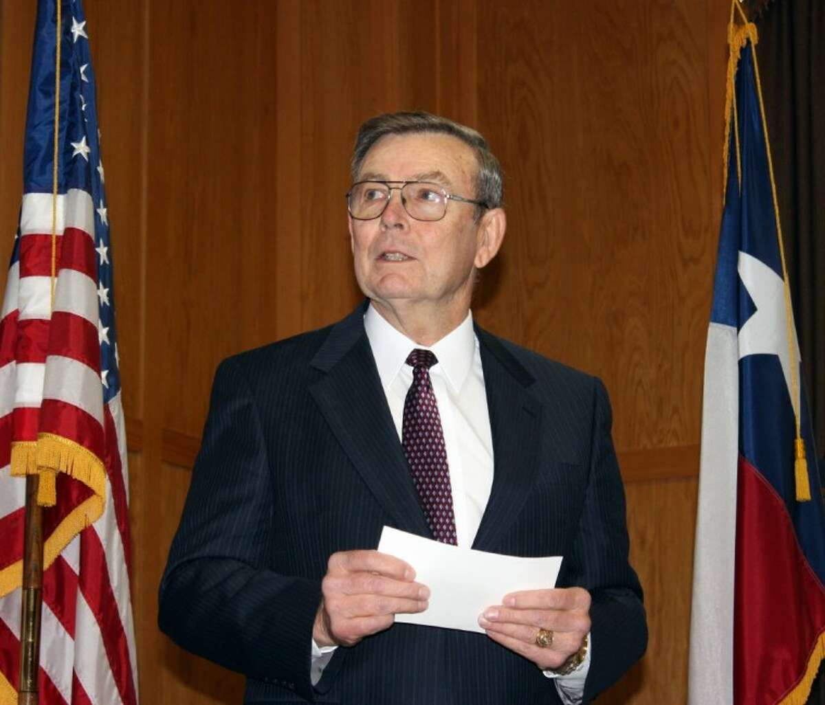 Retiring Waller County Judge Owen Ralston makes some departing remarks Saturday during the swearing in ceremony for the recently elected county officials. Ralston has been in government service for 49 years, the last eight as county judge.