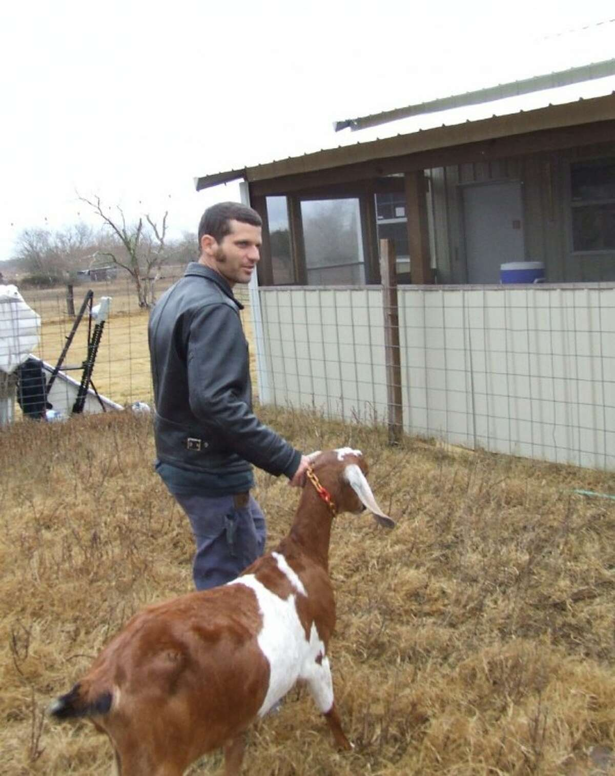 Christian Seger leads a goat back to his pen at Blue Heron Farm in Waller. There he and his wife run and operate the farm to milk goats to make cheeses. The cheese is then sold at the Magnolia Farmers Market.