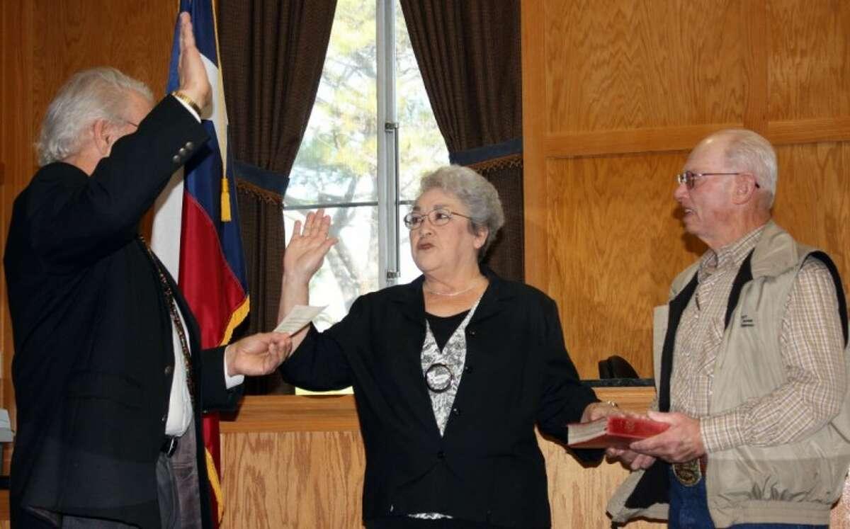 Justice of the Peace, Precinct 2, Delores Hargrave is sworn in Saturday by retiring Judge Dan Beck.