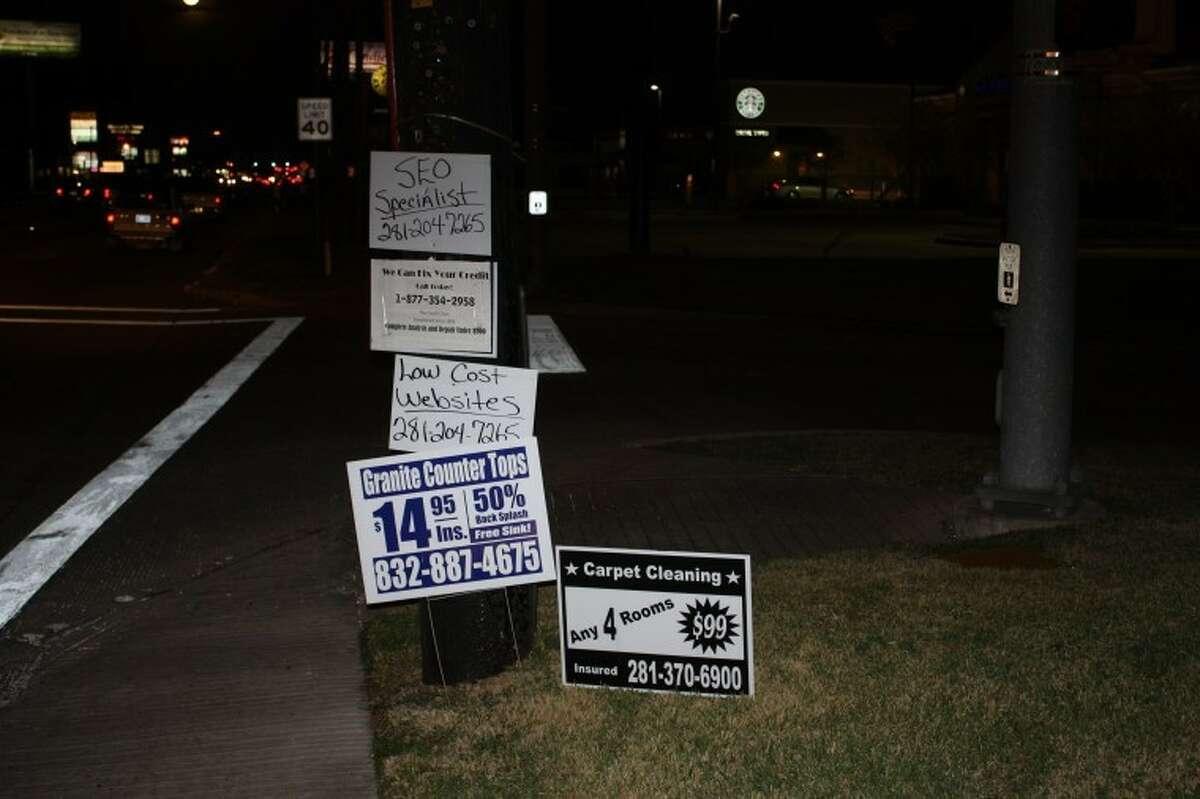 Residents take on bandit signs