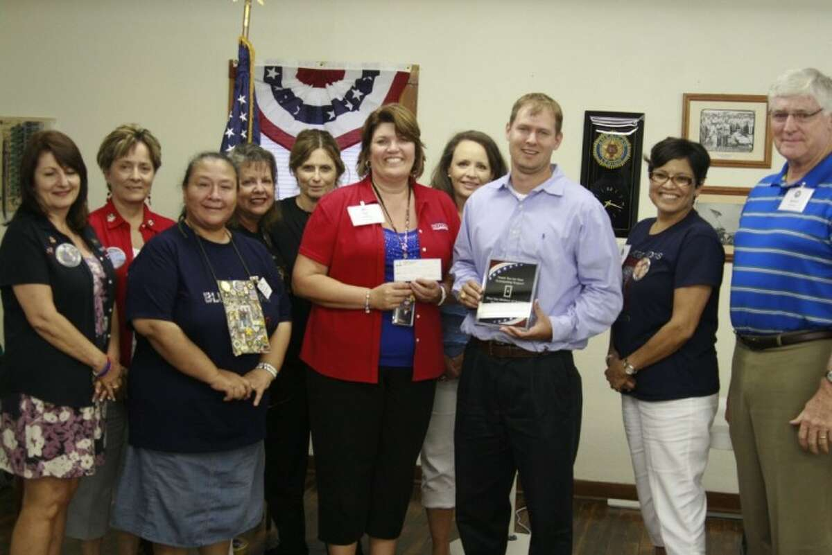 Scott Mitchell, founder of Kingwood Fallen Heroes Golf Tournament, presented a check to the Blue Star Mothers Greater Houston Chapter in June 2012. They are gearing up for their second annual Golf Tournament in April.