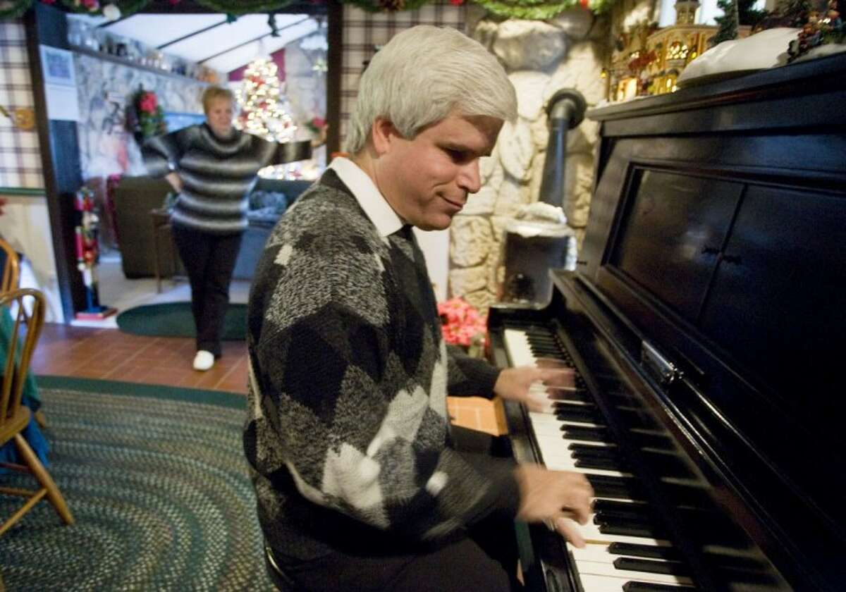 Blind pianist Hayden Braun plays the piano at his home in Conroe.