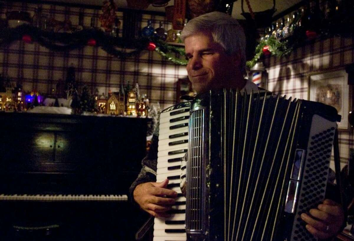 Hayden Braun plays the accordion at his home in Conroe.