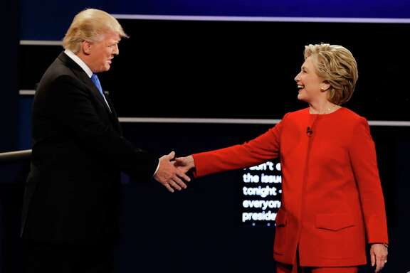Republican presidential nominee Donald Trump and Democratic presidential nominee Hillary Clinton shake hands during the presidential debate at Hofstra University in Hempstead, N.Y., Monday, Sept. 26, 2016. Business executives in Texas' service sector believe the U.S. presidential election is putting a hamper on the economy but express optimism about future business conditions, according to two outlook surveys released by the Federal Reserve Bank of Dallas on Tuesday.