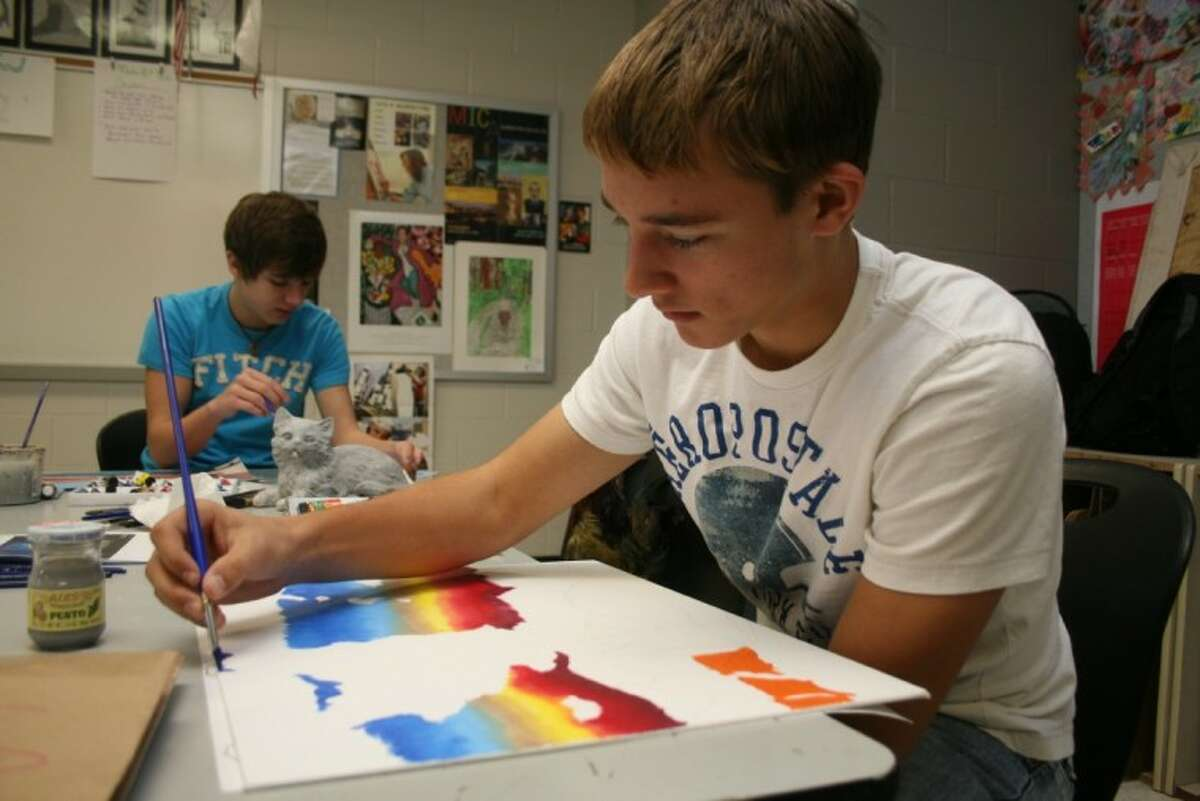 Hargrave junior George Mitchell, right, finishes his water color project for the Houston Livestock Show and Rodeo Art Contest. Judges from the HLSR will visit the campus this week to judge entries. Sophomore Austin Embree, in the back, is working on his project.
