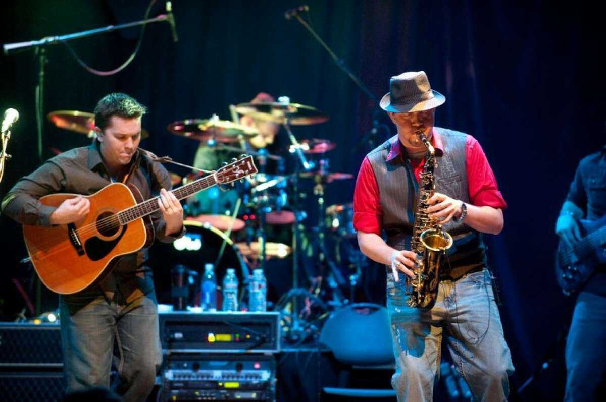 The Jud Johnson Band performs at Houston's House of Blues. (left to right) Johnson, drummer Ben Sandstrom and saxophonist Zach Spruill.