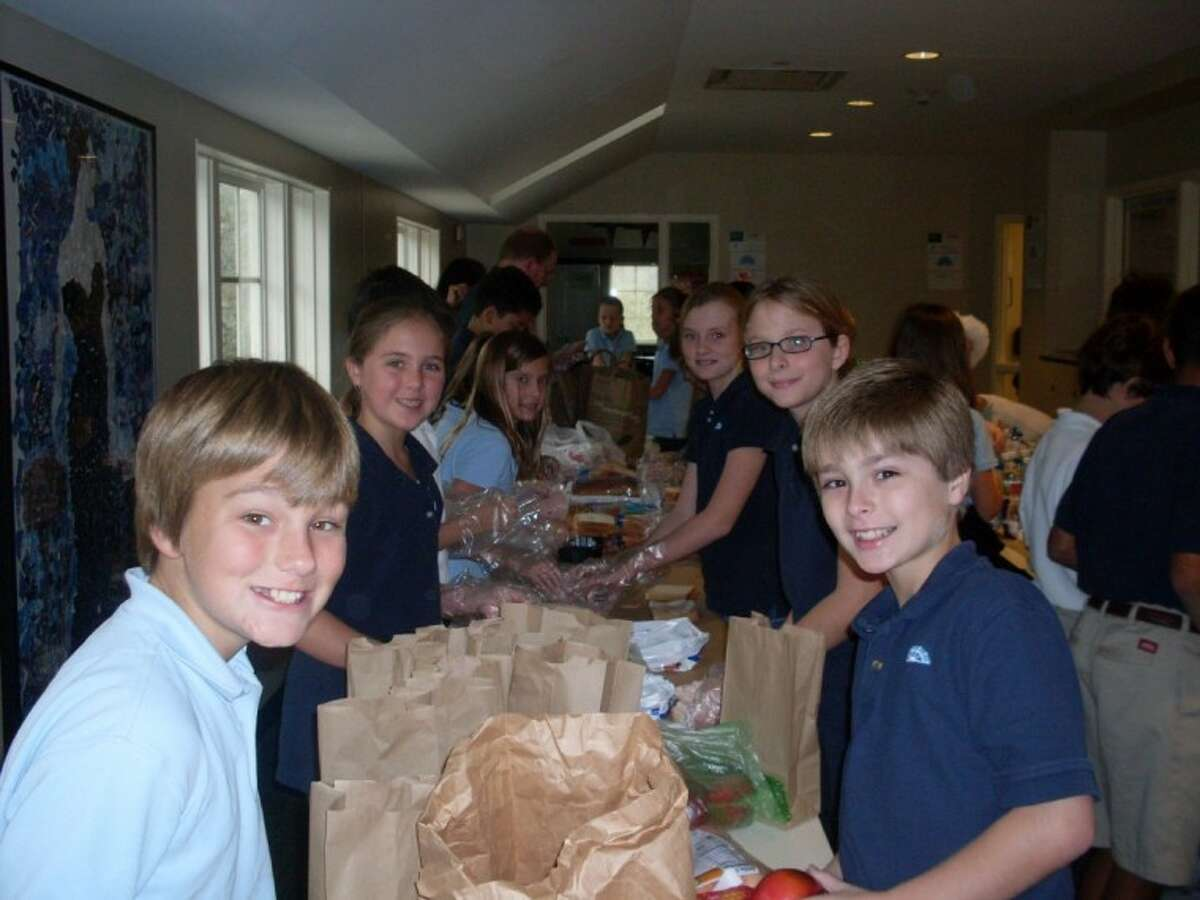 Fifth-grade students, Sam Jacobs, Megan Finkel, Rachel Koch, Arabel McFarland, Emily Kernell and Daniel Davis set up an assembly line to package sack lunches during Presbyterian School's annual Day of Service. (Photo submitted)