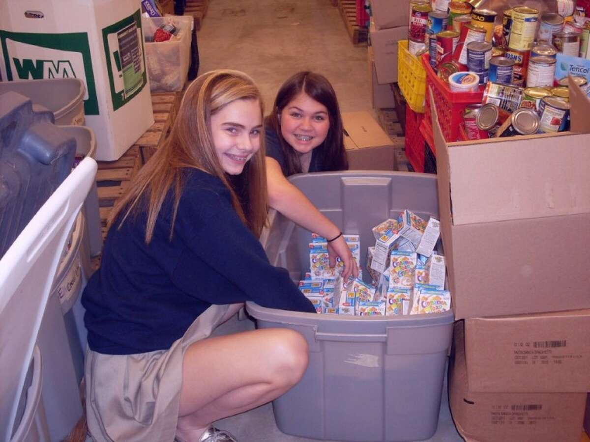 Seventh-grade students, Spencer Mclean and Allie McNear, cheerfully sorted food at the Christian Community Service Center during Presbyterian School's annual Day of Service. (Photo submitted)