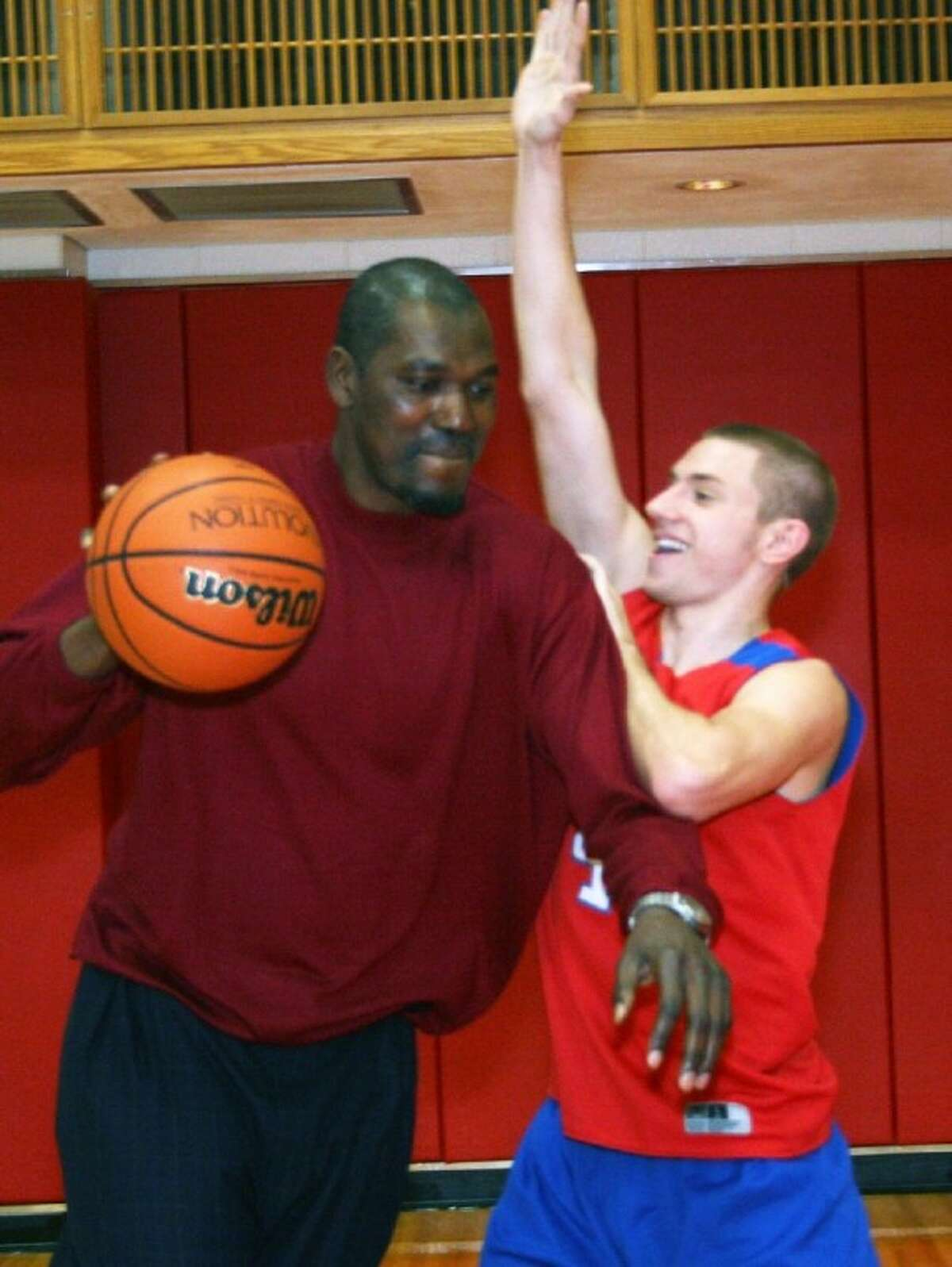 Former Houston Rockets star Hakeem Olajuwon played one-on-one with junior Ian Bates during a visit to Tomball High School .