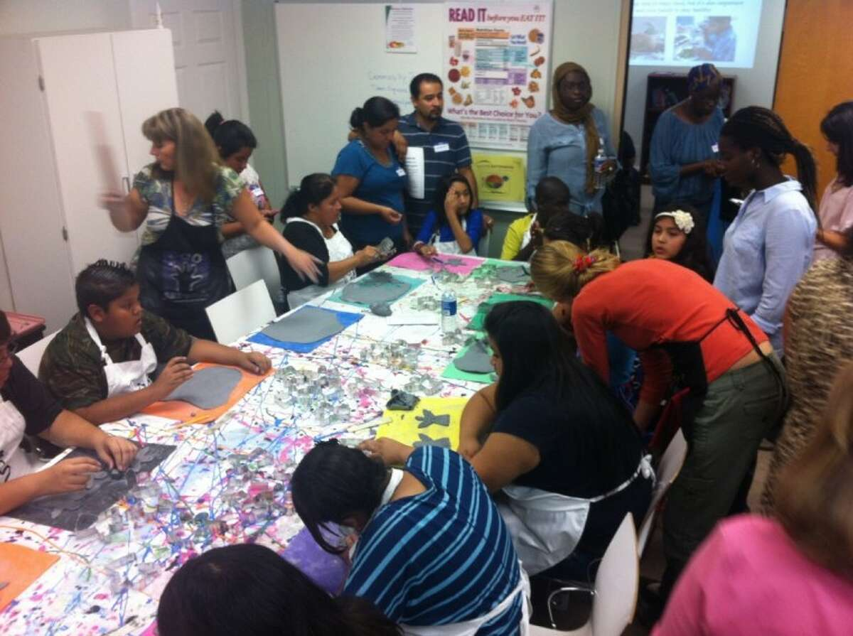 Fifty people crowd Christ Clinic for an art program sponsored by ARTreach.
