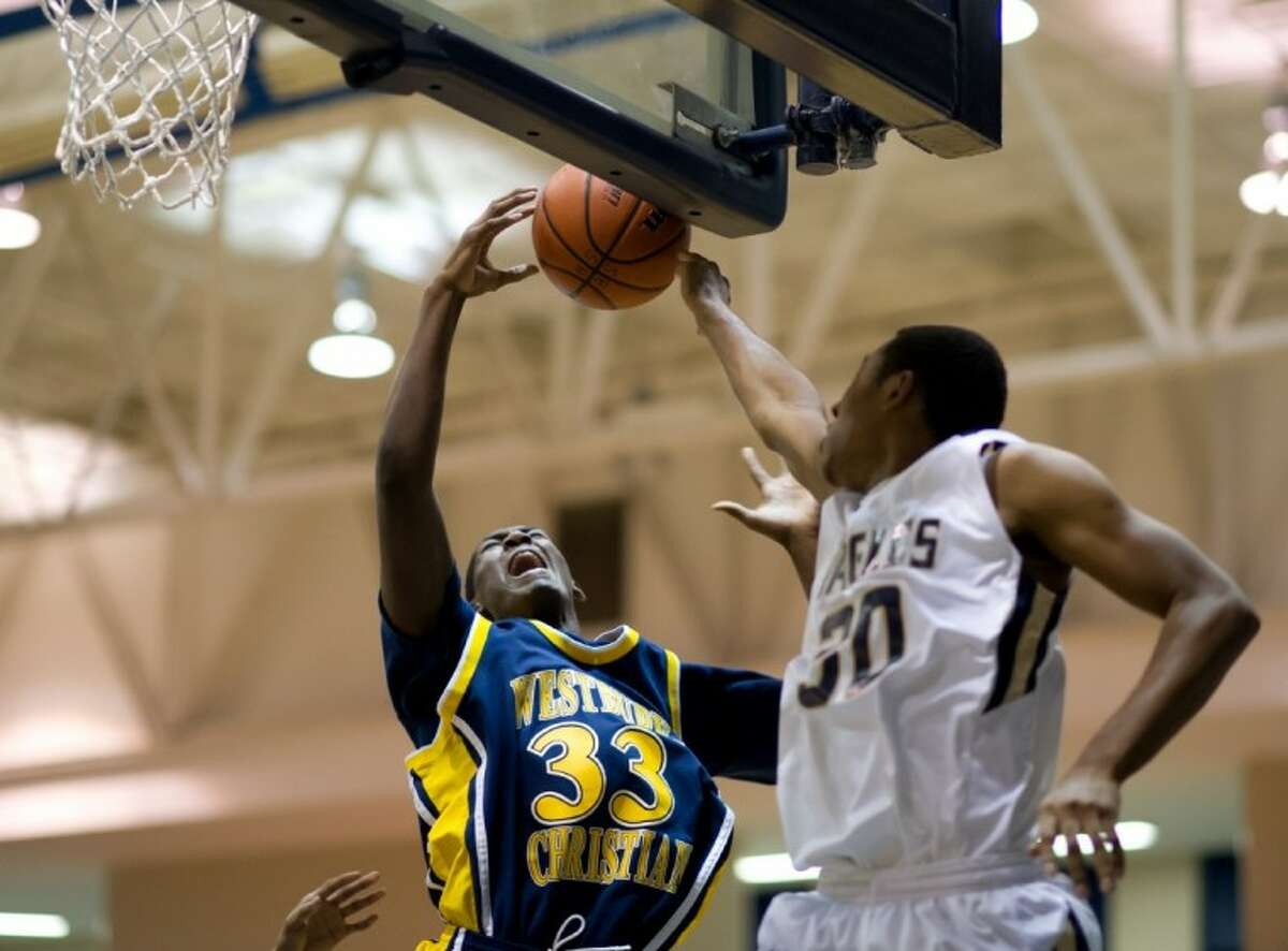 Brandon Jones of Westbury Christian and Alex Leavell of Second Baptist battle for a rebound Tuesday at SBS.