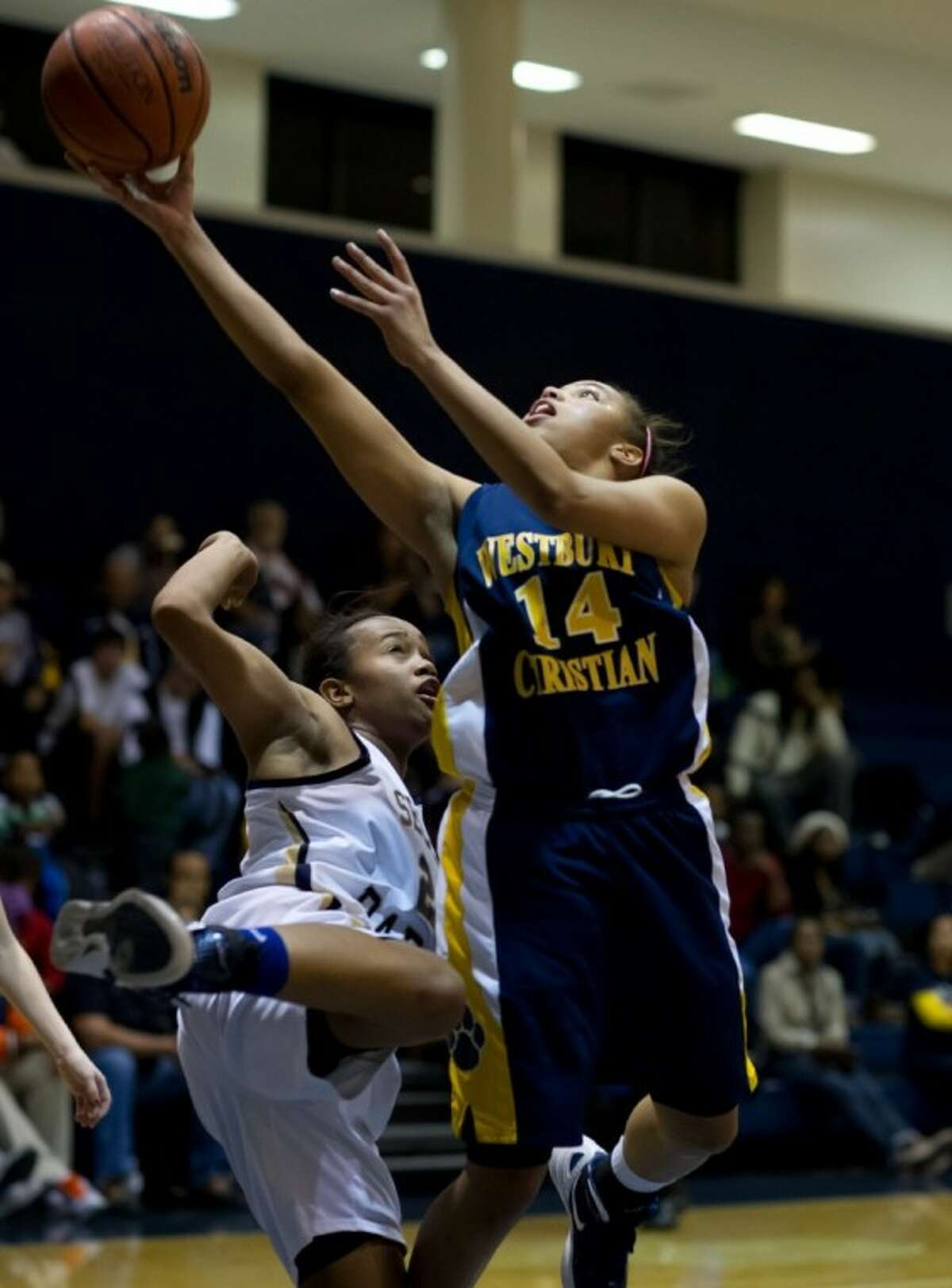 Tiffany Davis (14) led Westbury Christian with 26 points as the Lady Wildcats extended their district winning streak.