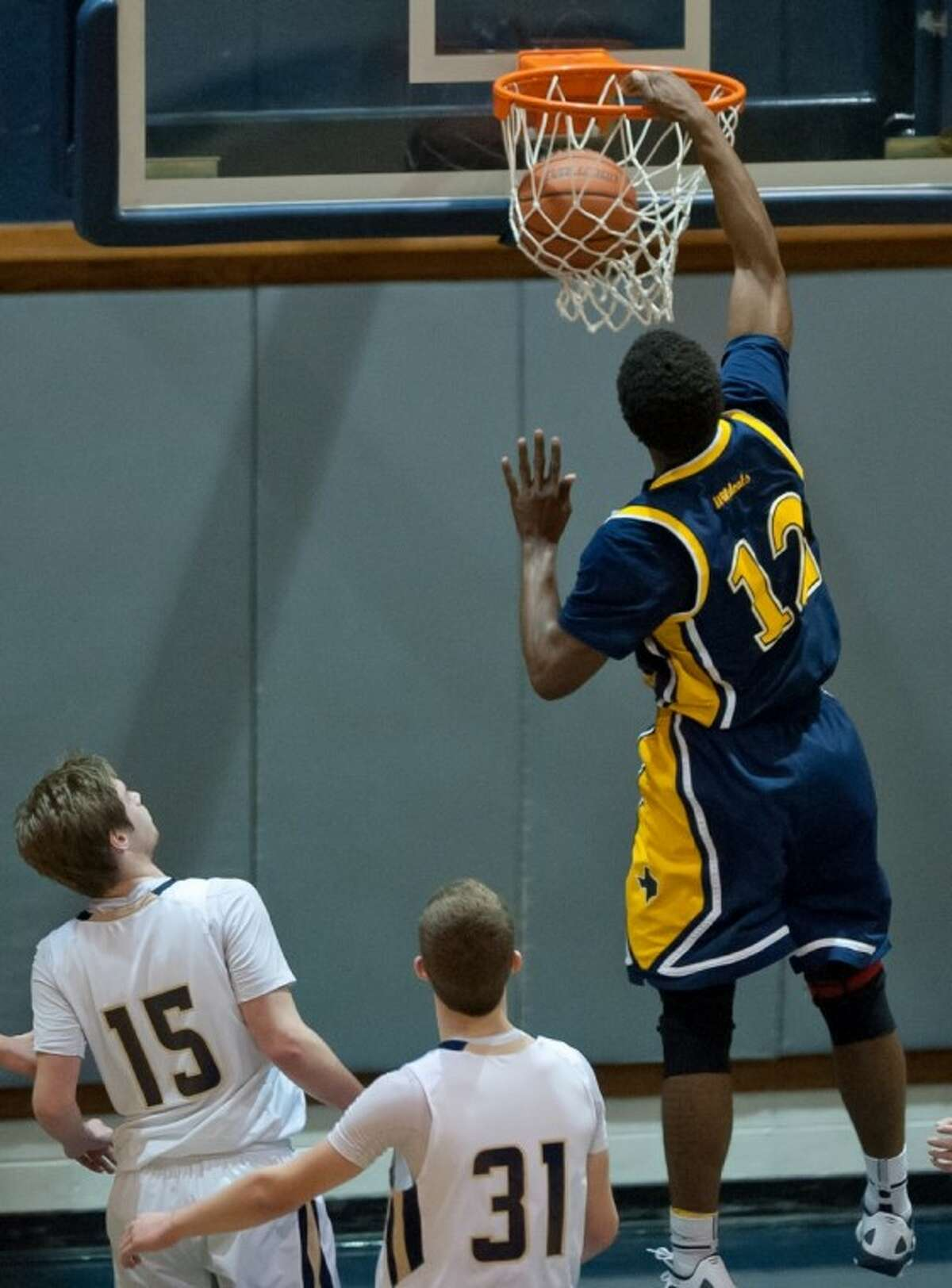 Delvin Dickerson pounds home two of his game-high 18 points as Westbury Christian defeated Second Baptist 70-38.