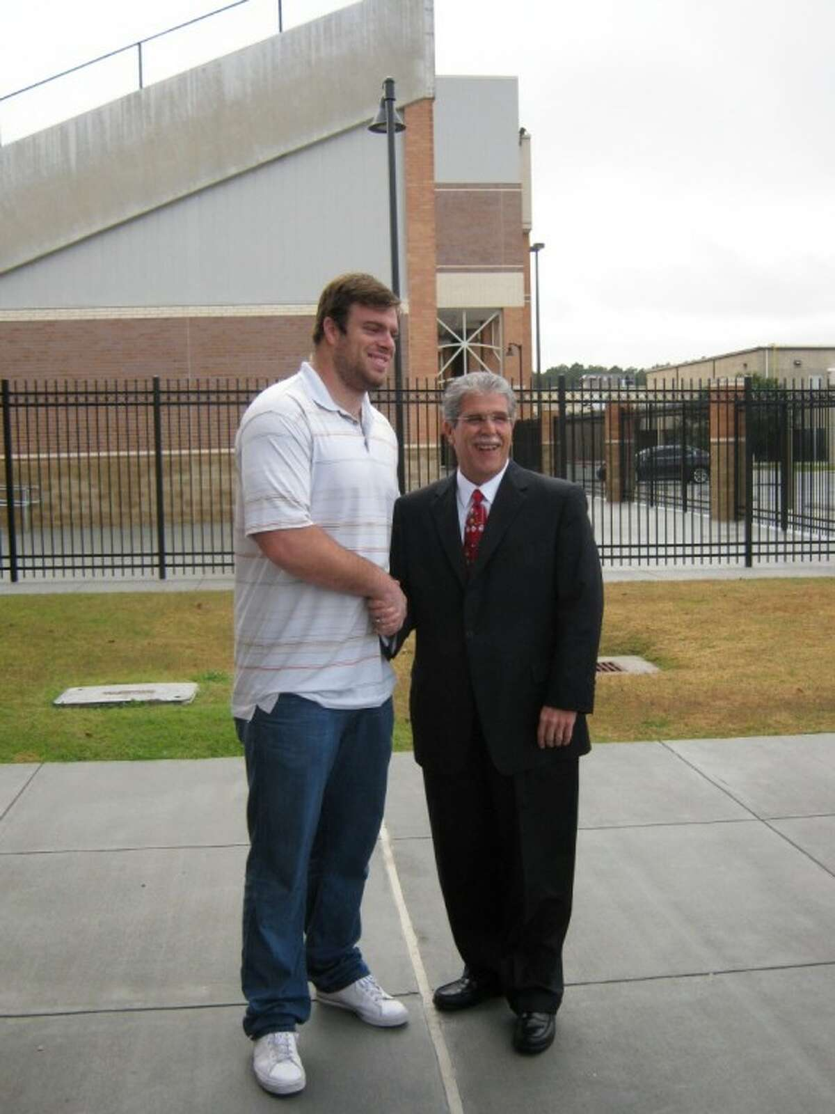 Humble ISD Superintendent Dr. Guy Sconzo welcomes Houston Texans right tackle Eric Winston as a guest of Texan GMC-Buick at a press conference Jan. 5 announcing the sponsorship of the dealership at Turner Stadium.