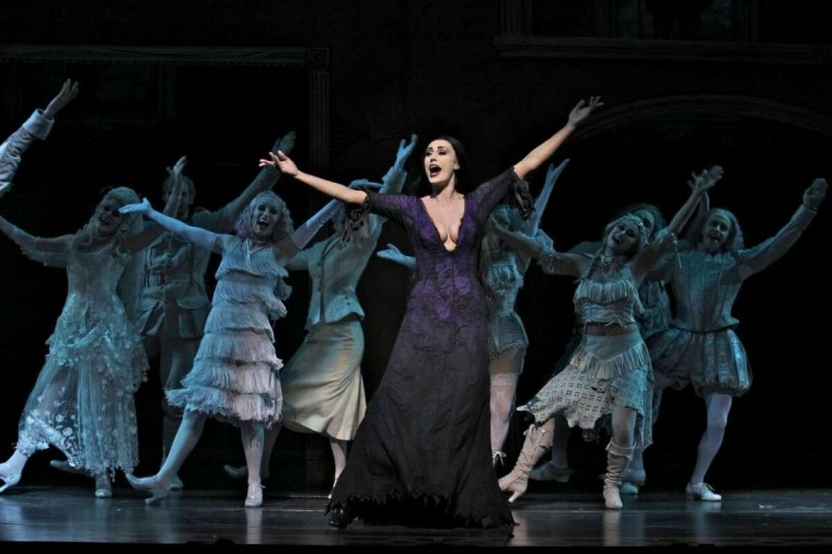 Sara Gettelfinger, as Morticia, and Company in THE ADDAMS FAMILY. (Photo by Jeremy Daniel)