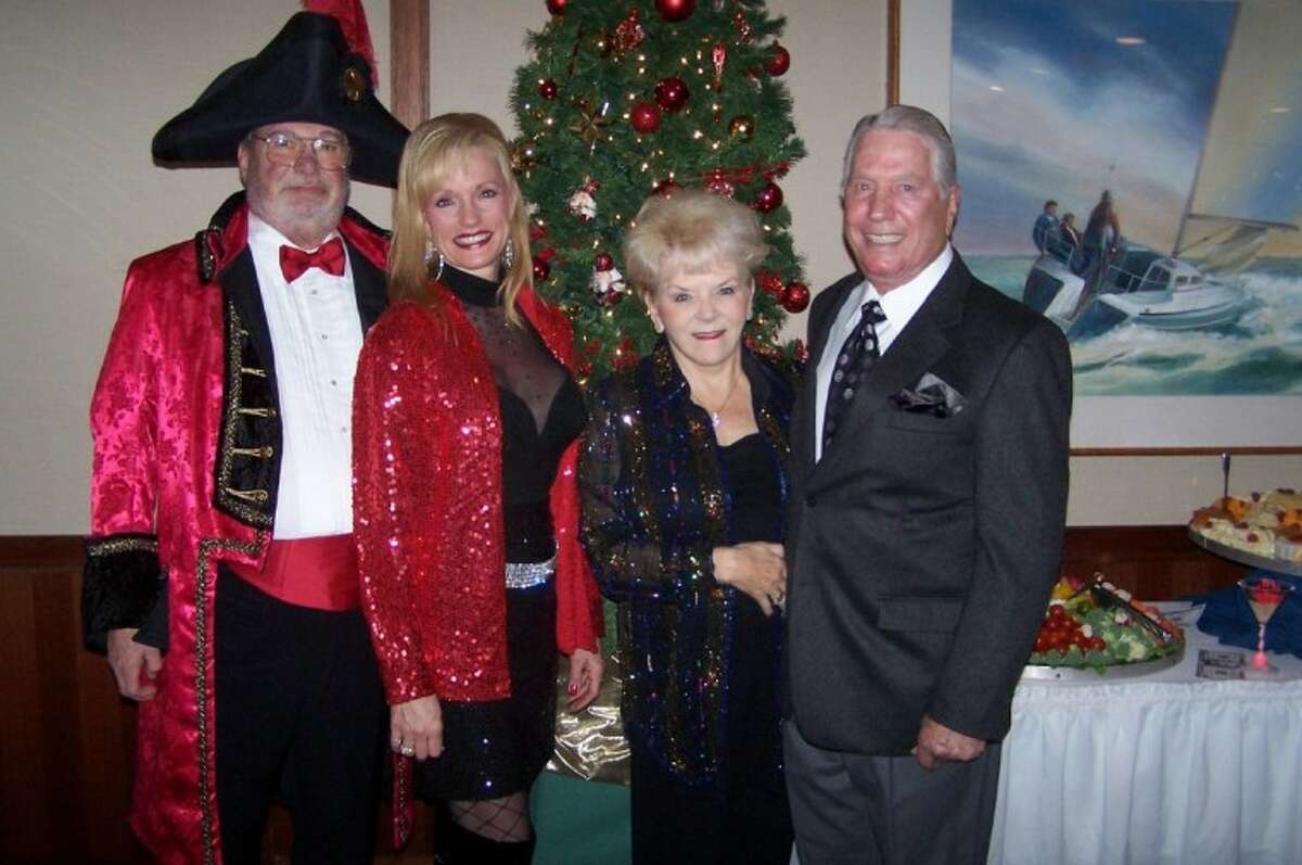 Jim Blair and his wife, Nelda, a University of Houston regent, are all decked out for the Lakewood Yacht Club New Year's Eve Celebrate as they join Neal and Leona Pleasant.