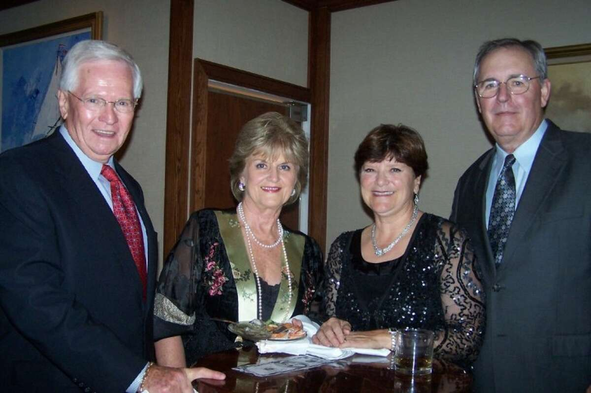 Frank and Ann Muffeny, left, say hello to Mike and Kathy Hall during Lakewood Yacht Club New Year's Eve Celebration.