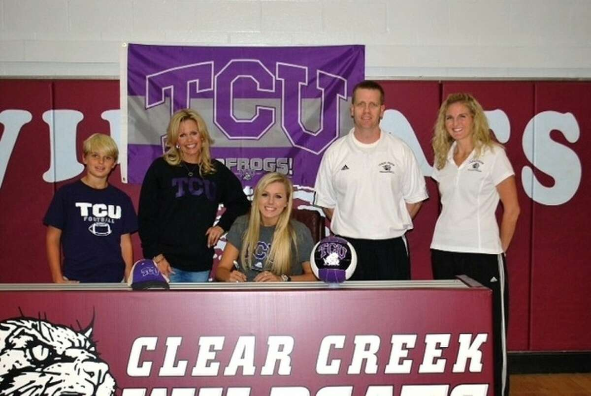 Ashley Smith recently signed a volleyball letter of intent with TCU. Shown with Ashley (left to right) are he brother, Hunter; mother, Marcy; Clear Creek head volleyball coach Scott Simonds and Creek assistant coach Molly Ullmann.