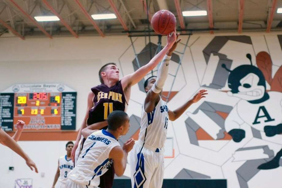 Chris Holbrook attempts a rebound against Clear Springs during a pool game at last weekend's Lions Holiday Classic in Alvin. Photo: KIRK SIDES