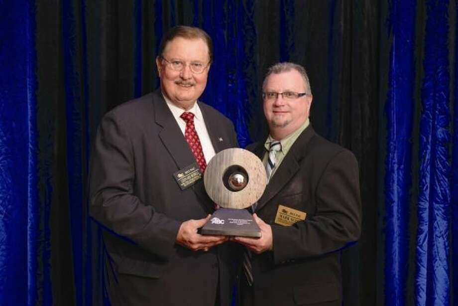 Leonard A. Bedell, president & CEO of Mobil Steel, and Mark Scott, general manager of Mobil Steel, accepting the 2012 ABC Houston Business Excellence Award.