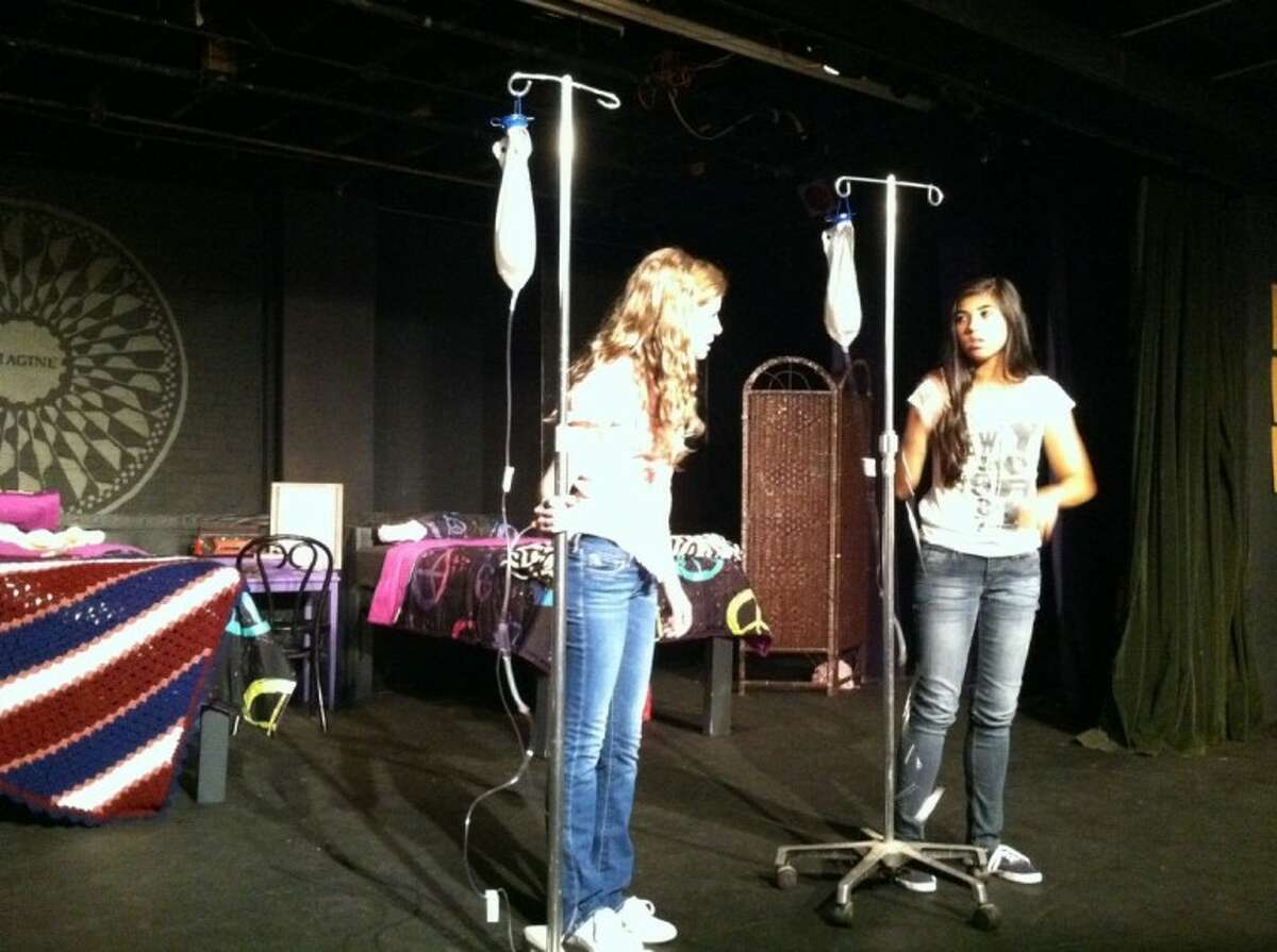 Courtney (Emma Jobes) is complaining to Star (Danielle Troiano) about having to wear an IV when her school crush Tom Lowell comes for a visit during a showing of