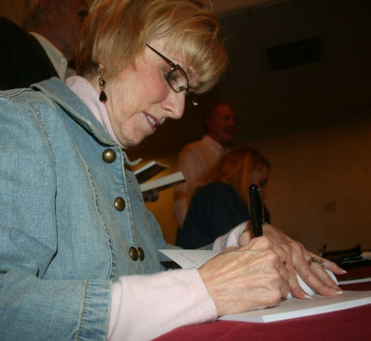 State Rep. Debbie Riddle (R-Dist. 150) signs a copy of her book, titled