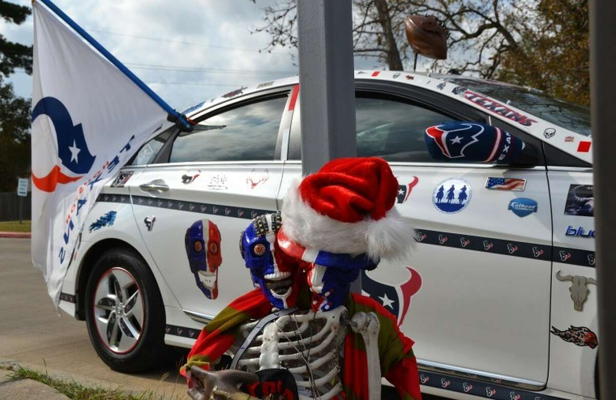 Mike Linsky, a resident of Atascocita, has spent much of the past five months decorating his car with Houston Texans gear. His work has drawn a lot of attention from fans all around the Greater Houston area, including the Texans cheerleaders. Linsky's skeleton sidekick,
