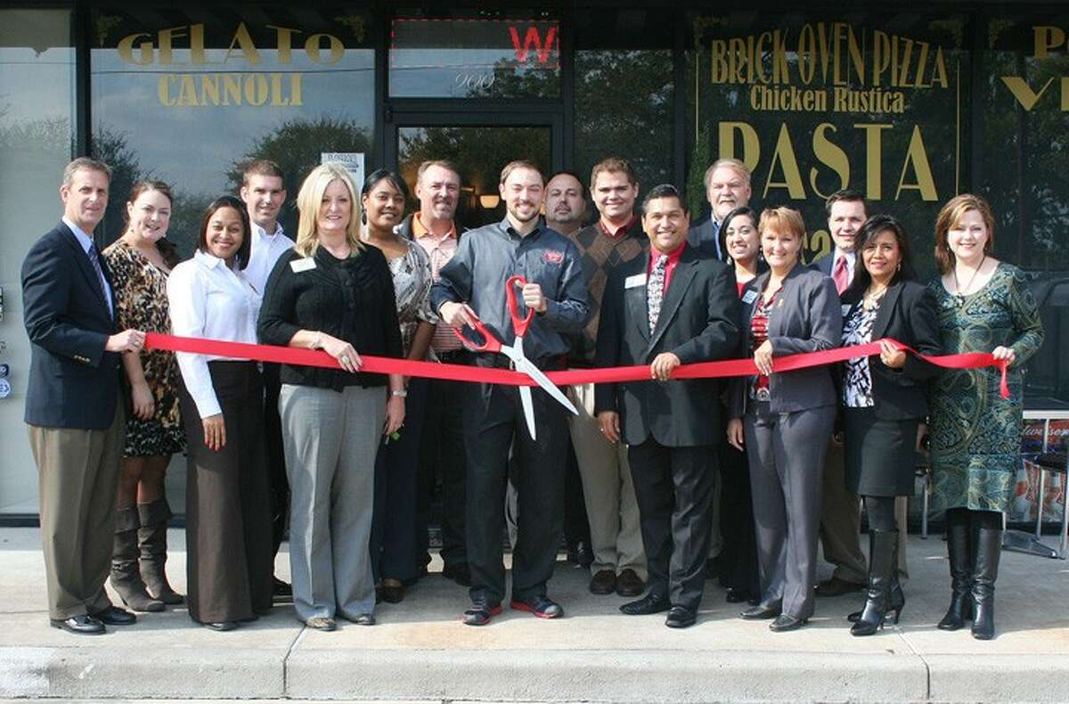 The Central Fort Bend Chamber Alliance recently held a ribbon cutting ceremony for Russo's New York Pizzeria Greatwood, 6560 Greatwood Pkwy., Ste. 900 in Sugar Land. From left: Terry Crockett, NewFirst Bank, Alicia Davis, Central Fort Bend Chamber Alliance, Brian Ellis, Houston Community Bank, Chamber President Shanta Kuhl, Mike Shaw, Fort Bend Toyota, Ben Knapp, Russo's New York Pizzeria, Jim Wilkinson, Fort Bend Toyota, Matt Ontivaros, Springhill Suites Marriott Rosenberg, Gilbert Limones, First Victoria National Bank, Mike McCroskey, Macro Remodeling & Restoration Services, Lisa Matthews, Servpro of West Fort Bend County, Josh Fields, Office of Pete Olson, U.S. Representative, Texas Dist. 22, Liz Moreno, Fort bend County Women's Center, Suzanne Loehr, Stieber Insurance Group.