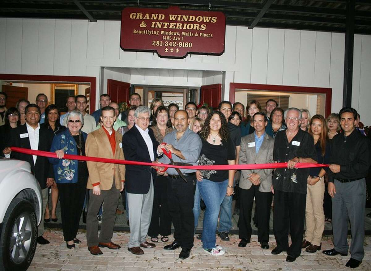 The Central Fort Bend Chamber Alliance recently held a ribbon cutting ceremony for Grand Windows and Interiors ,1405 Avenue I in Rosenberg. From left: Gilbert Limones, First Victoria National Bank, Liz Moreno, Fort Bend County Women's Center, Terry Crockett, NewFirst Bank, Shirley Jackson, La Casona Restaurant, David Martin, Garcia-Martin & Martin, Adam Bartling, AT&T, Matt Ontivaros, Springhill Suites Marriott Rosenberg, Caron Lopez, Grand Windows & Interiors, Candelario Lopez, Grand Windows & Interiors, Michele Barnes, QB Data, Andres Novoa, La Cocina Restaurant; Melisaa Garcia-Martin, Garcia-Martin & Martin, Chamber Board Chair Thomas J. Crayton, CPA, Jeff Trinker, Rosenberg development Corporation, Cathy Pitts, SIG: McDonald & Wessendorff Insurance, Tom Wilson, Reading Road Self Storage, Chamber President Shanta Kuhl, Darrell Karnopp, Network Funding, LP.