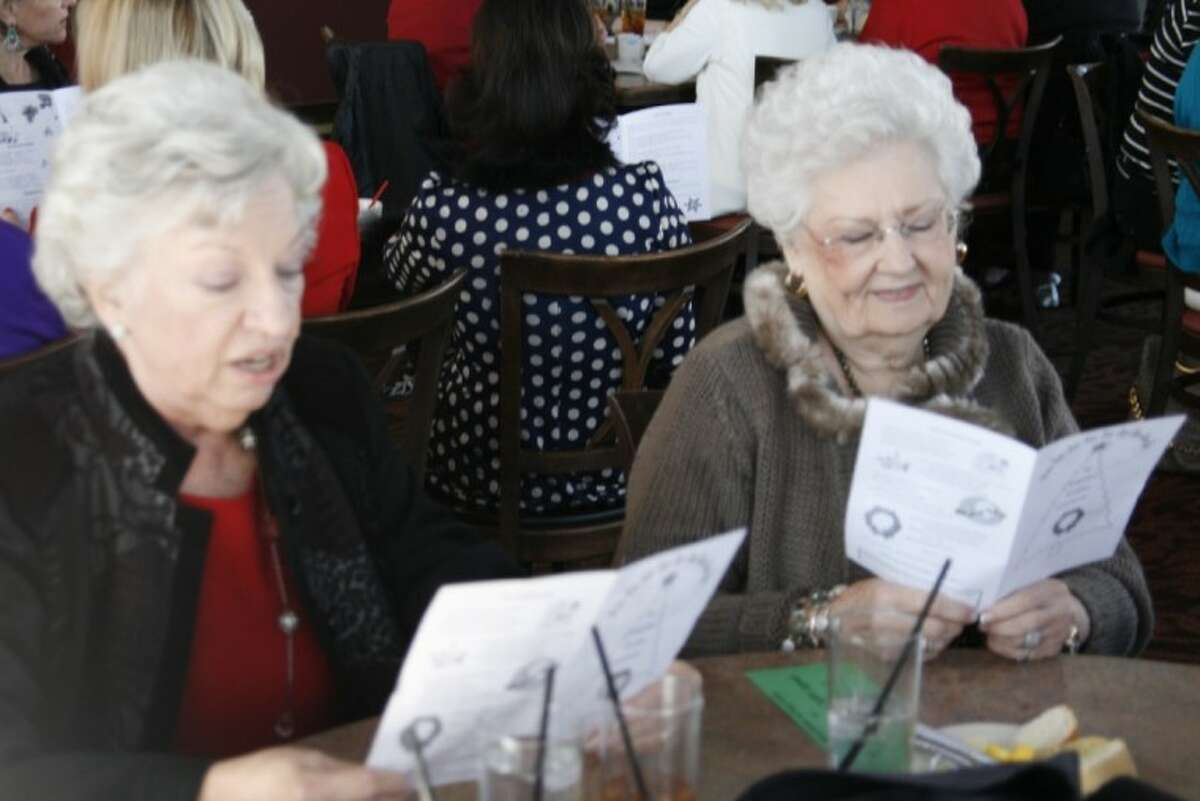 Kingwood Hi Neighbor members enjoyed singing Christmas carols at their Dec. 12 luncheon where they each brought a gift for FamilyTime to use in their Christmas Store.