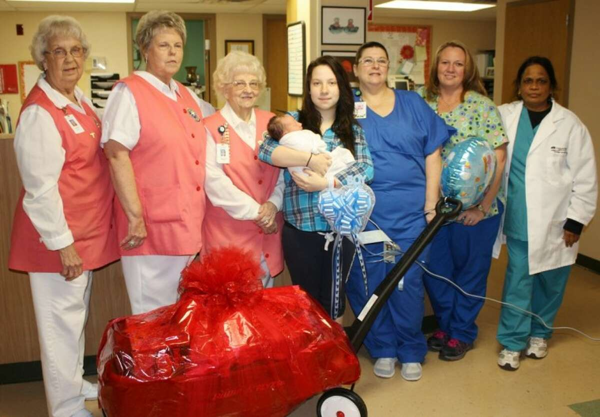 Cleveland Regional Medical Center staff and volunteers celebrated the first baby born in 2013. Shown from left to right are Betty Bell, Delores Mathews, Madie Jones, baby Hank James Varnado, mother DeeAnn Schank, Labor Nurse Melissa Stockman, Nursery Nurse Kathy Christopher and Dr. Mary Garnepudi who delivered the baby.