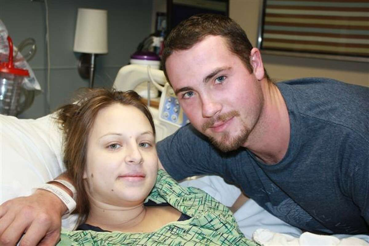 Area residents Tabitha and Scott Scaggs welcomed the first babies of 2012 at Kingwood Medical Center - twins named Madilynn and Lane.