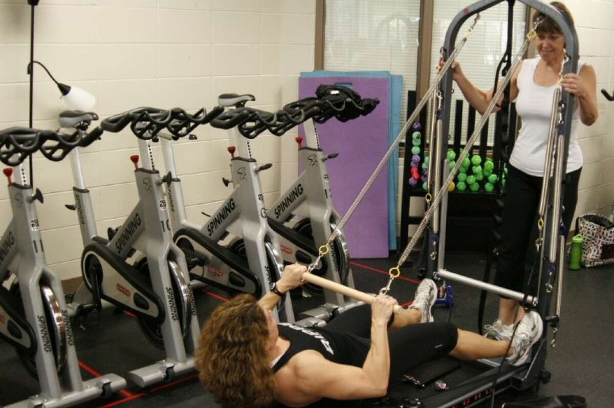 The Lake Houston Family YMCA recently added tower Pilates to its traditional Reformer Pilates class which will allow for guests to enhance their workout and work with resistance.