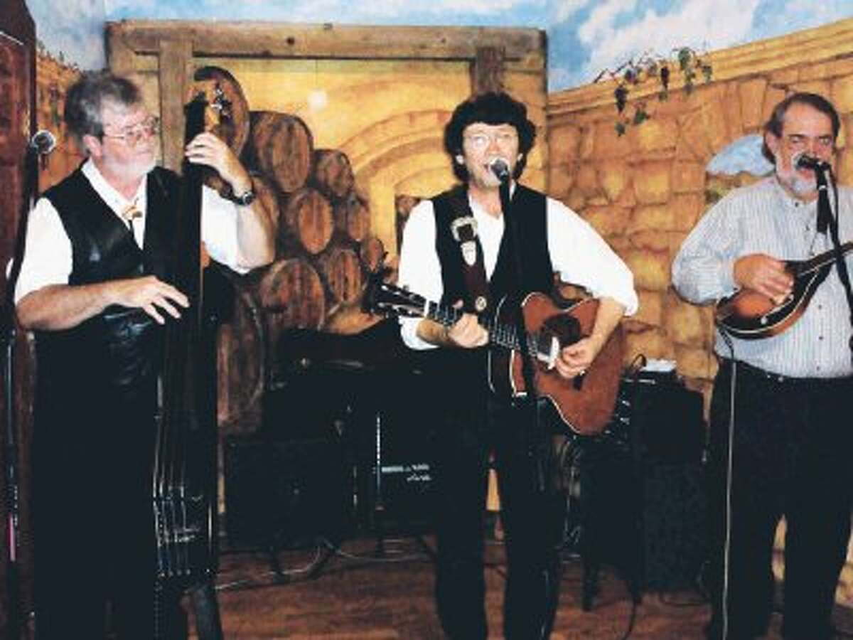 Shake Russell, center, and Michael Hearne perform at Bernhardt Winery on Jan. 13. in the 'Winter Madness' House Concert Series.