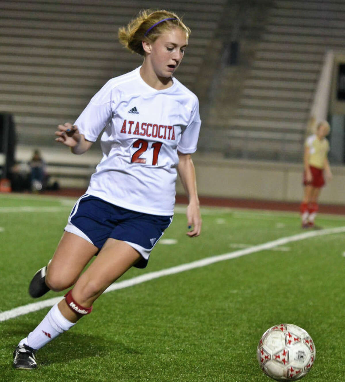 Hannah Hearn dribbles near the sideline during the first half of Atascocita's 2-1 loss to Cy Woods in an opening-round match at the Humble ISD Women's Soccer Invitational on Jan. 10.