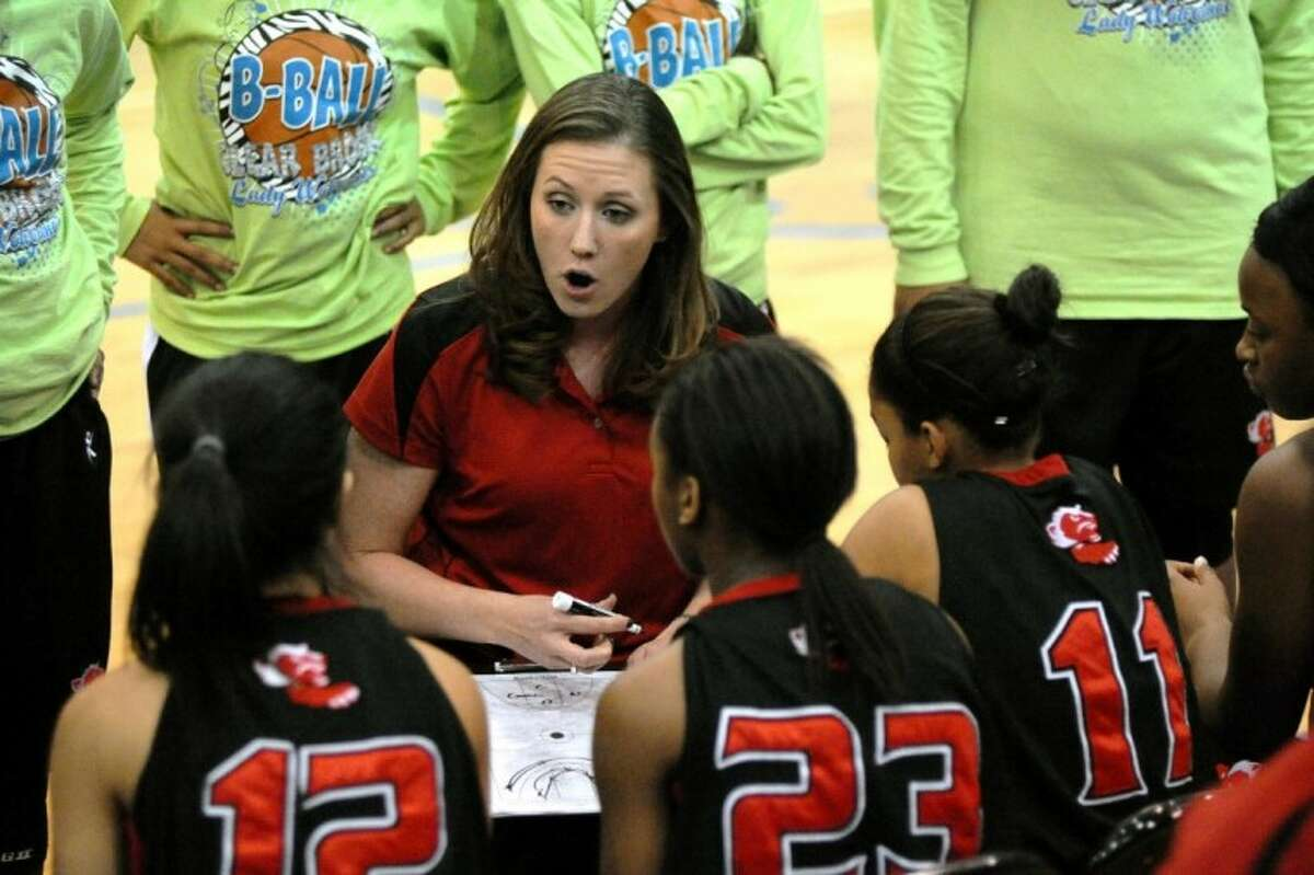 Clear Brook head coach Blair Redmon talks to her team during a timeout against Clear Springs Friday night. The Lady Chargers won, 79-28.