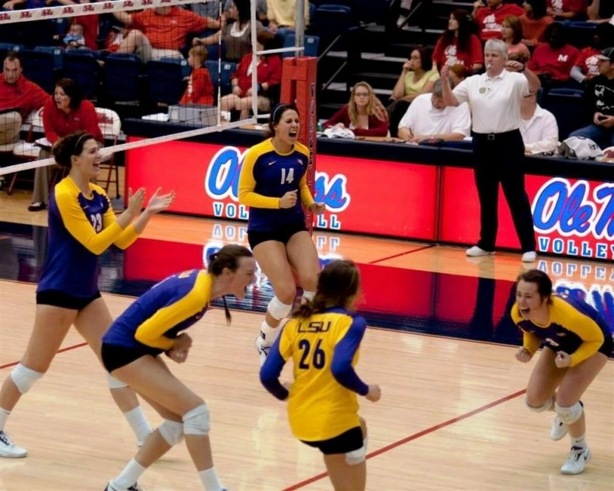 Malorie Pardo (14) celebrates with her teammates during an SEC game.