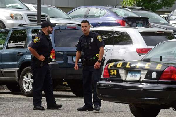 Norwalk police respond to Norwalk High School, where a reported gunshot was heard in the lower parking lot putting the school on lock out status for a brief period Tuesday.