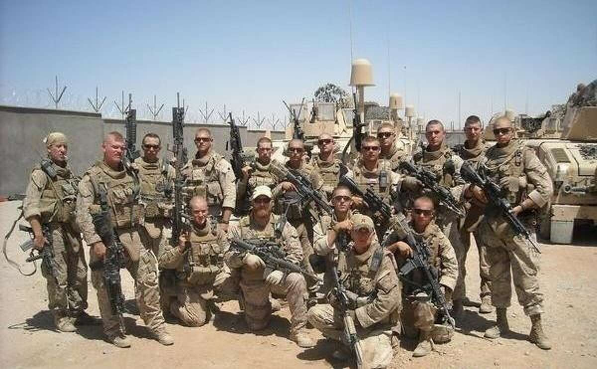 Sgt. William W. Rollins (seen here with the Marines in his unit) is among the newest recipients of a Silver Star. Rollins was awarded the Silver Star for his brave actions in Afghanistan when his squad was engaged by a well-armed squad of enemy forces. Out of nine Marines in the squad, four were injured.