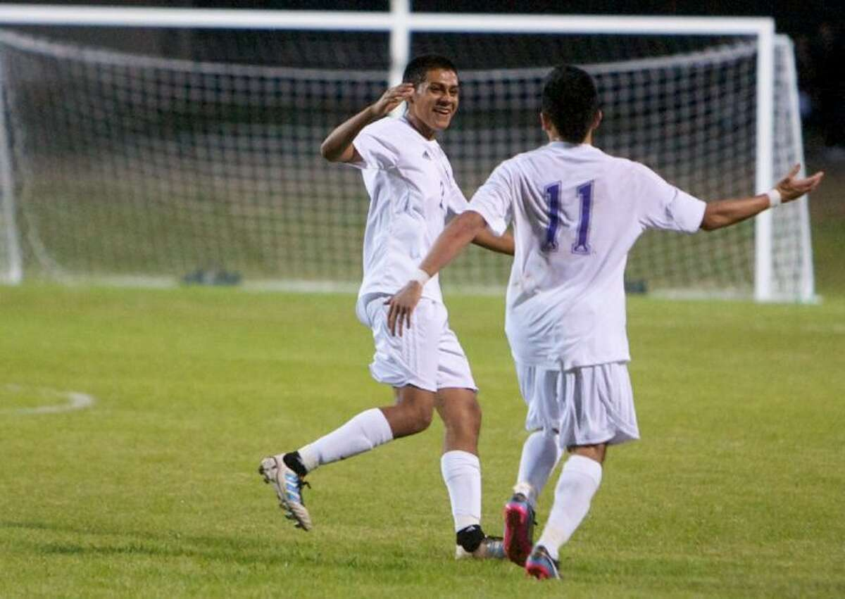 Willis' Guillermo Solano, left, and Candelario Martinez celebrate Martinez's goal in the 19th minute of Friday night's Kat Cup match against Splendora.