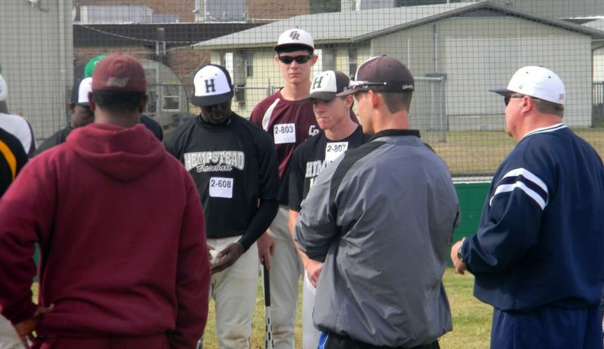 Sam Blackmon (East Texas Baptist University), Marqus Johnson (Texas Southern University), and Adam Skonieczki (Texas A&M - Corpus Christi) are pictured giving private instruction to athletes during the Winter College Baseball Showcase. Hempstead's Obie Wilder and Trey Trojan (center) were among the athletes. Hitting instruction was the topic during this group discussion.