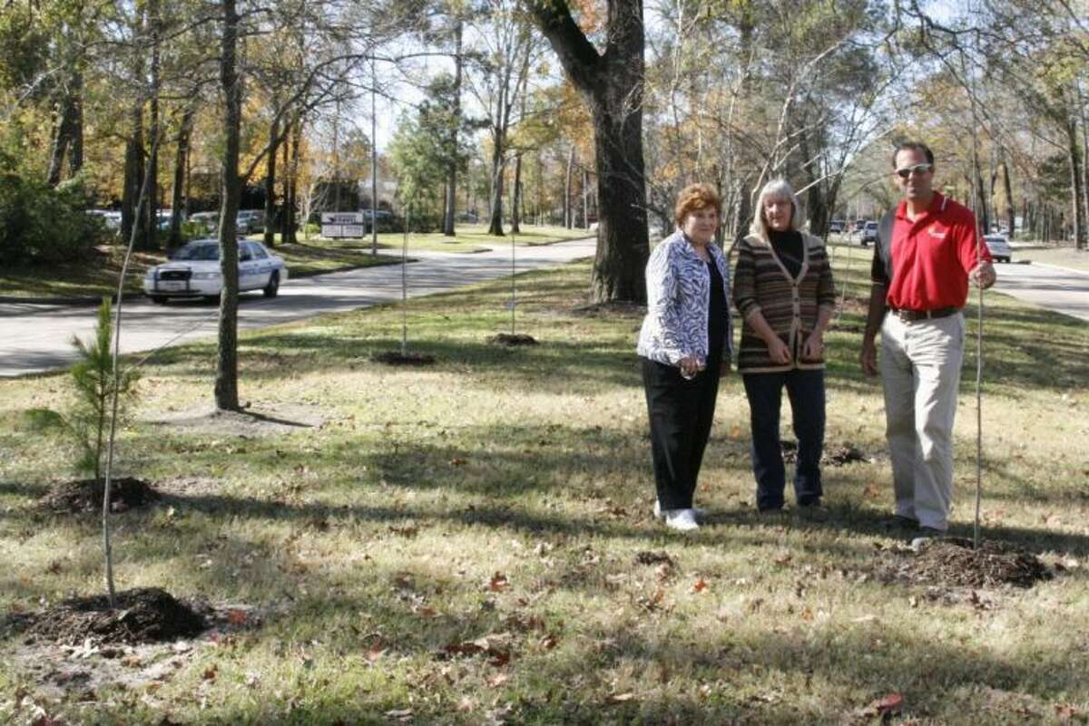 From left, Ann Korenek and Kate Henderson with the Kingwood Garden Club and Shawn Smith with Lake Houston Lawn Care, check out the progress of some of the trees planted on the neutral ground of Kingwood Drive as a part of the club's