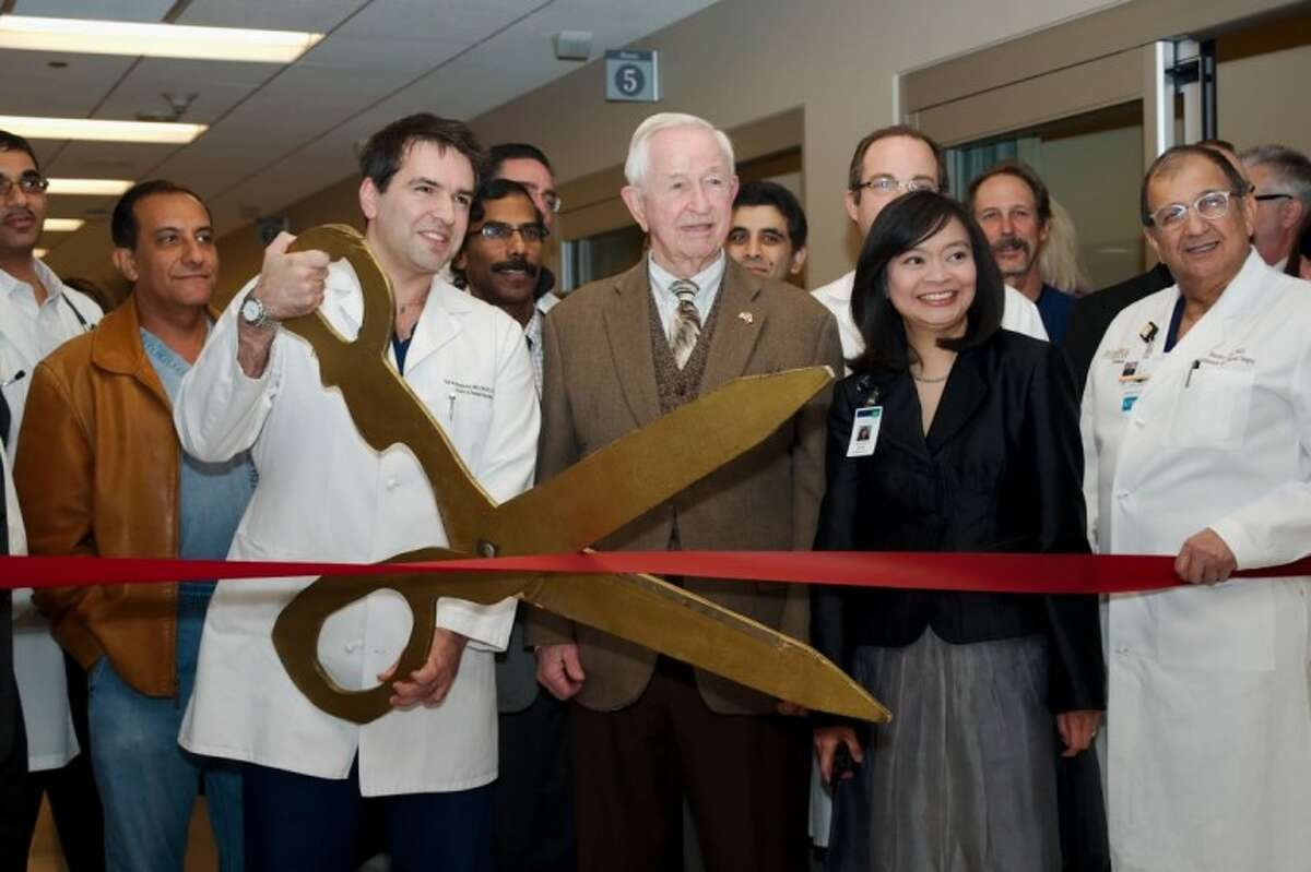 Pearland mayor Tom Reid, middle, stands with Dr. Ted Voloyiannis and Memorial Herman Southeast hospital CEO Erin Asprec as they prepare to cut the ribbon and officially dedicate the new perioperative services facility expansion Tuesday, Jan. 8.